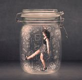 Business woman captured in glass jar with hand drawn media icons Stock Photos