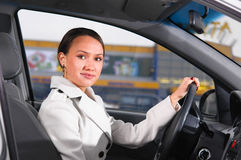 Business woman in a car Royalty Free Stock Photo