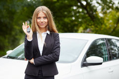 Business woman with car key Stock Image