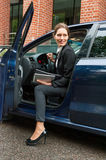 Business woman in a car Stock Images
