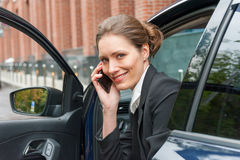 Business woman in a car Stock Photography