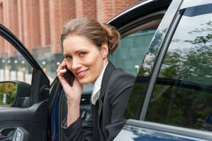Business woman in a car Royalty Free Stock Photography