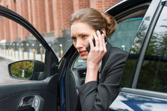 Business woman in a car Royalty Free Stock Image