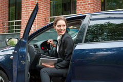 Business woman in a car. Young business woman in a car portrait Royalty Free Stock Images