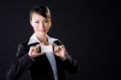 Business woman with a card. Business woman presenting a blank card Royalty Free Stock Image