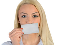 Business woman with card. Isolated business woman cover lips with card Stock Image