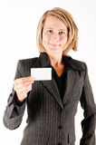 Business woman with a card. Business woman showing a card Stock Photo