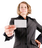Business woman with a card. Business woman showing a card Royalty Free Stock Images