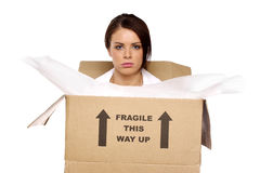 Business woman in a cardboard box Royalty Free Stock Photos