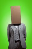 Business woman with a cardboard box head. On a green background Royalty Free Stock Images