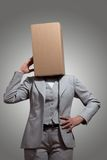 Business woman with a cardboard box head. On a gray background Stock Photo
