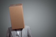 Business woman with a cardboard box head. On a gray background Stock Photography