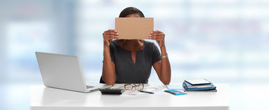 Business woman with cardboard on face Stock Photo