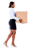Business woman carrying a box Royalty Free Stock Photo