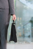 Business woman carrying briefcase Royalty Free Stock Photos