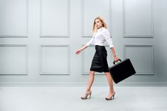 Business woman carrying a briefcase. stock photography