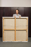 Business woman carrying canvas Stock Photo