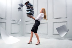 Business woman carrying a pile of papers. Conception of overwork and paper work Stock Photography