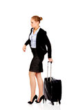 Business woman carrying a suitcase Stock Images