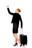 Business woman carrying a suitcase and looking up Royalty Free Stock Photo