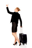 Business woman carrying a suitcase and looking up Royalty Free Stock Images