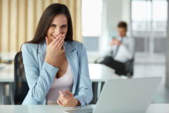 Business Woman Celebrates Something at her Workplace Stock Images