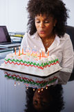 Business Woman Celebrating Birthday Party In Office Blowing Cand Royalty Free Stock Photos