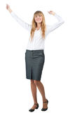 Business woman celebrating her success. Full length portrait of successful young business woman raising her arms in joy. Isolated on white background Stock Photo