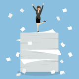 Business woman celebrating on a lot of documents Stock Images