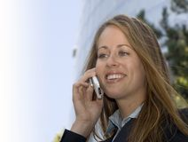 Business Woman - On a cell phone. A business woman is on her cell phone royalty free stock images