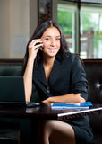 Business woman on cell phone Stock Photos