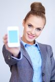 Business woman with cell phone Stock Photography