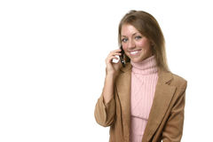 Business Woman on Cell Phone. Smiling, with text area on left royalty free stock photos