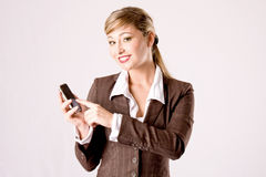 Business woman with cell phone Royalty Free Stock Photo