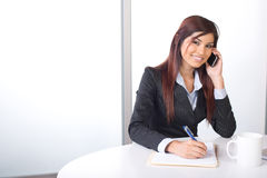 Business woman on a cell phone Royalty Free Stock Images