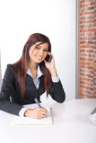 Business woman on a cell phone Stock Photography