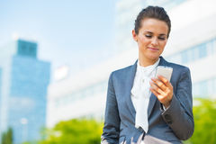 Business woman with cell phone in office district Stock Image