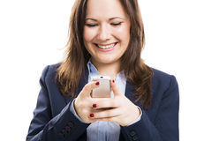 Business woman with a cellphone texting Stock Images