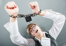 Business woman with chained hands. Crime, arrest jail or business concept. Angry unhappy emotional woman with chained hands on grunge background Stock Image