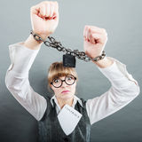 Business woman with chained hands. Crime, arrest jail or business concept. Angry unhappy emotional woman with chained hands on grunge background Stock Photos