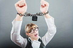 Business woman with chained hands. Crime, arrest jail or business concept. Angry unhappy emotional woman with chained hands on grunge background Royalty Free Stock Image