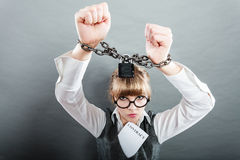 Business woman with chained hands. Crime, arrest jail or business concept. Angry unhappy emotional woman with chained hands on grunge background Royalty Free Stock Photo
