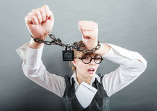 Business woman with chained hands. Crime, arrest jail or business concept. Angry unhappy emotional woman with chained hands on grunge background Stock Photography