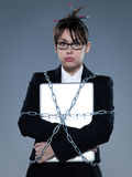 Business woman chained to her her computer laptop. Beautiful business woman on isolated bacground chained to her computer laptop royalty free stock photo