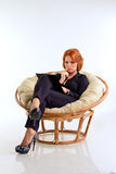 Business woman in chair Stock Photography