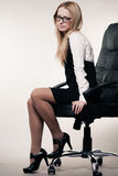 Business woman in chair Royalty Free Stock Images