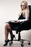 Business woman in chair Royalty Free Stock Photo