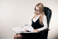 Business woman in chair Royalty Free Stock Photos