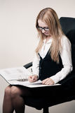 Business woman in chair Stock Images