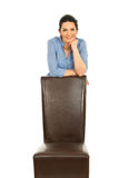 Business woman with chair Royalty Free Stock Image